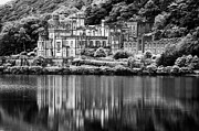 Historical Building Prints - Kylemore Abbey reflected in the lake Connemara galway ireland Print by Joe Fox