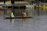 Greenery Photos - Ladies plying a small boat in the Dal Lake in Srinagar - in fron by Ashish Agarwal