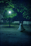 Lady In Vintage Clothing Walking By Lamplight Print by Jill Battaglia