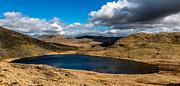 Lake Teyrn Snowdonia Print by Adrian Evans