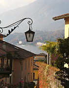 Rebecca Baker Metal Prints - Lamp in Lake Como Metal Print by Rebecca Baker