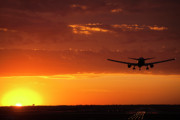 Airliner Prints - Landing into the Sunset Print by Andrew Soundarajan