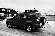 Cans Art - large 4x4 vehicle prepared for winter travel with extra fuel Honningsvag harbour finnmark norway eur by Joe Fox