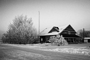 Sask Prints - large residential traditional house with communications mast in rural village Forget Saskatchewan  Print by Joe Fox