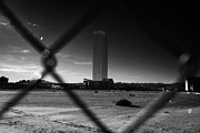 Unused Photo Prints - Las Vegas Plaza Chain Link Fence Around Empty Vacant Unused Lot With View Towards The Trump Tower On Print by Joe Fox