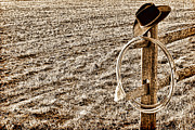 Cowboy Hat Framed Prints - Lasso and Hat on Fence Post Framed Print by Olivier Le Queinec
