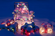 Lawn Chair Framed Prints - Lawn Chairs with lit Christmas presents Framed Print by Jim Corwin