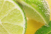 Fizz Posters - Lemon and lime slices in water Poster by Simon Bratt Photography