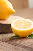 Mythja Posters - Lemon fruit  Poster by Mythja  Photography