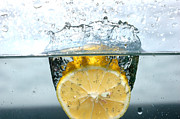 Coolness Photo Prints - Lemon splash into water Print by Michal Bednarek
