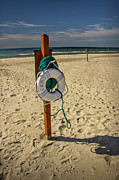 Lifebelt Prints - Life Preserver on the Beach in Pentwater Michigan Print by Randall Nyhof