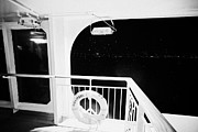 Lifebelt Framed Prints - lifebelt on board the hurtigruten ship ms midnatsol at night in winter in Tromso troms Norway Framed Print by Joe Fox