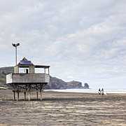 Surfboards Posters - Lifeguard Tower and Surfers Bethells Beach New Zealand Poster by Colin and Linda McKie