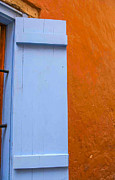 Patricia Hofmeester - Light blue shutter against orange wall