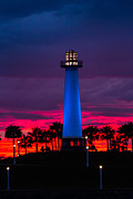 Light House In The Firey Sky Print by Denise Dube