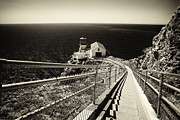 Curving Lines Framed Prints - Lighthouse on the Edge  Framed Print by George Oze