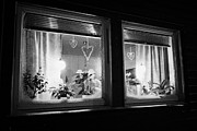 Winter Night Posters - Lights In The Window Of A Norwegian House To Mimic The Sun Vardo Finnmark Norway Europe Poster by Joe Fox