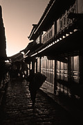 Timber House Prints - Lijiang Old Town Print by James Brunker