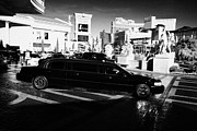 Limousine Prints - limousine outside caesars palace luxury hotel and casino Las Vegas Nevada USA Print by Joe Fox