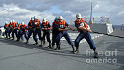Hard Hats Posters - Line Handlers Heave Around Aboard Uss Poster by Stocktrek Images