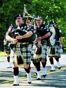 Bagpiper Prints - Line of Bagpipers Print by Susan Savad