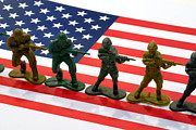 American Flag Acrylic Prints - Line of Toy Soldiers on American Flag Crisp Depth of Field Acrylic Print by Amy Cicconi
