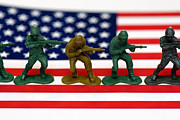 Stripes Prints - Line of Toy Soldiers on American Flag Shallow Depth of Field Print by Amy Cicconi