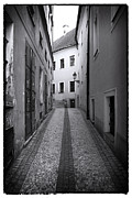 Cobblestone Prints - Lined Up in Prague Print by John Rizzuto