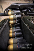 Operation Enduring Freedom Photos - Linked 40mm Rounds Feed Into A Mark 19 by Stocktrek Images
