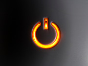 Home Appliance Prints - Lit Power Button In Orange Color Print by Jose Elias - Sofia Pereira