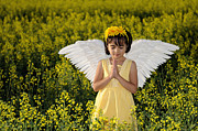 Praying Hands Posters - Little Angel Praying In A Field Of Yellow Flowers Poster by Kriss Russell
