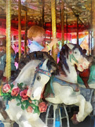 Carousel Framed Prints - Little Boy on Carousel Framed Print by Susan Savad