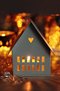Sandra Cunningham - Little gray house lit with candle for the holidays