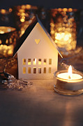 Sandra Cunningham - Little white house lit with candle for the holidays