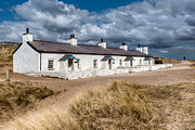 Gravel Posters - Llanddwyn Cottages Poster by Adrian Evans