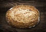 Round Prints - Loaf of multigrain artisan bread Print by Elena Elisseeva