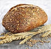 Golden Photo Prints - Loaf of multigrain bread Print by Elena Elisseeva