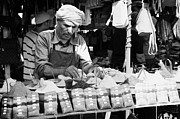 Local Arab Man Measuring Out A Quantity Of Spice For Sale On Stall Of Spices At The Market In Nabeul Tunisia Print by Joe Fox