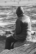 Autumn Photographs Posters - Lone Man Sitting on a Rocky Beach Poster by Natalie Kinnear