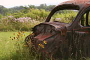 Rusted Cars Posters - Lonely Car on the Prairie Poster by Binsar Marseto
