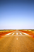 Straight Prints - Long Straight Road Marked Out as Emergency Runway Print by Colin and Linda McKie