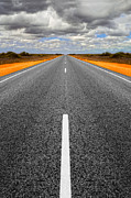 Navigate Posters - Long Straight Road with Gathering Storm Clouds Poster by Colin and Linda McKie