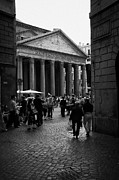 Narrow Streets Prints - looking back through narrow cobblestone streets at tourists and the Pantheon Rome Lazio Italy Print by Joe Fox