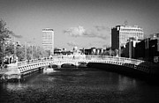 Repaired Photo Prints - Looking Down The Liffey Towards The Hapenny Ha Penny Bridge Over The River Liffey In Dublin Print by Joe Fox