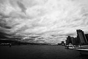 looking out from coal harbour into Vancouver Harbour on an overcast cloudy day BC Canada Print by Joe Fox