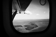 American Aircraft Posters - Looking Out Of Aircraft Window Flying Over Man Key In The Mule Keys Part Of Key West National Wildli Poster by Joe Fox