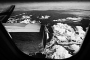 Snow-covered Landscape Photo Posters - Looking Out Of Aircraft Window Over Engine And Snow Covered Fjords And Coastline Of Norway Europe Poster by Joe Fox