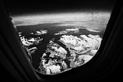 Snow-covered Landscape Photo Prints - Looking Out Of Aircraft Window Over Snow Covered Fjords And Coastline Of Norway  Print by Joe Fox