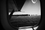 Dry Tortugas Prints - Looking Out Of Seaplane Window Coming In To Land On The Water In A Seaplane Next To Fort Jefferson G Print by Joe Fox
