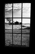 Sask Prints - looking out through door window to snow covered scene in small rural village of Forget Print by Joe Fox